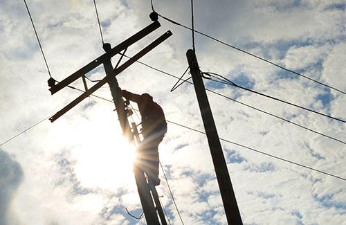 power company employee working